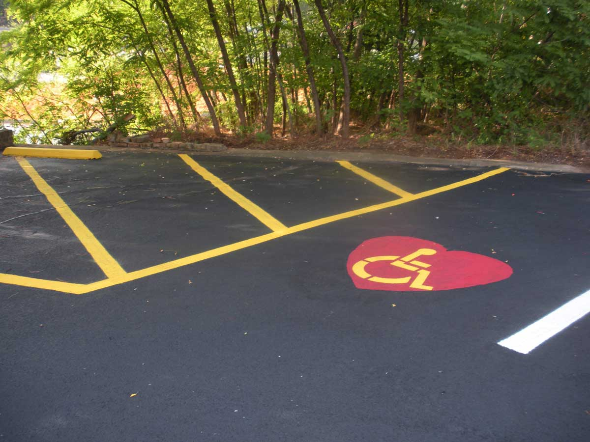 Line striping and stenciling for heart surgeon handicap stall