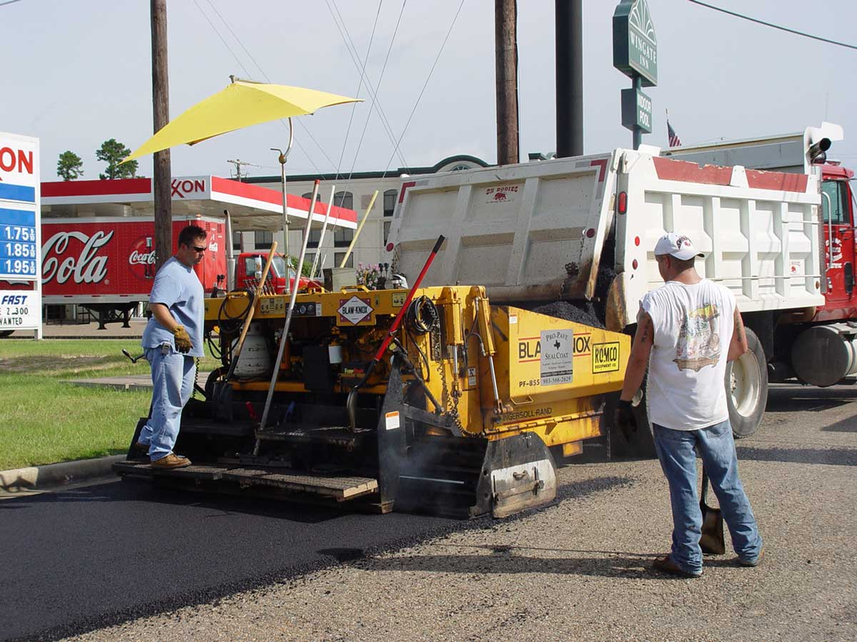 Pro-Pave crew operating machines to melt, spread and smooth new asphalt surface